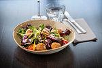 Salad and fried Mozzarella cheese balls dish at Italian Restaurant