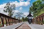 Bikers crossing temporary bridge, Nan, Thailand