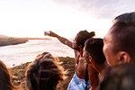 Friends taking selfie on beach, Pagudpud, Ilocos Norte, Philippines