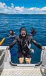 Scuba divers boarding dinghy after a dive, portrait, Raja Ampat, Sorong, Nusa Tenggara Barat, Indonesia