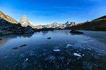 Frozen Riffelsee lake by Matterhorn in Switzerland, Europe