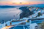 View of Oia village at sunset, Santorini, Cyclades, Aegean Islands, Greek Islands, Greece, Europe