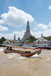 Wat Arun (Temple of Dawn), Ruea Hang Yao (long tail boat) on the Chao Phraya River, at sunset, Bangkok, Thailand, Southeast Asia, Asia