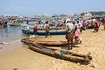 Fishing boats at Vizhinjam beach fish market, near Kovalam, Kerala, India, South Asia