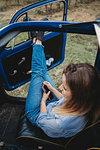 Woman daydreaming inside car