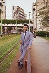 Businessman leaning against handrail, Milano, Lombardia, Italy