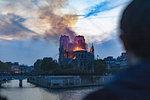 Man watching Notre-Dame de Paris fire from far, Paris, Ile-de-France, France