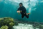 Diver near water surface, swimmers in background, Ko Racha Yai, Rawai, Phuket, Thailand