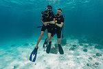 Couple divers holding hands, Ko Racha Yai, Rawai, Phuket, Thailand