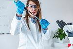 Laboratory technician with micropipette.