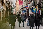 Couple holding hands on street in Stockholm, Sweden