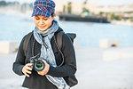 Tourist adjusting digital camera in town, Split, Dalmatian Coast, Splitsko-Dalmatinska, Croatia
