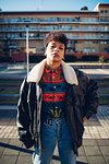 Cool young woman on urban sidewalk, portrait