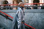 Stylish man going into subway station, Milan, Italy
