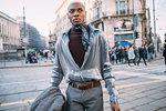 Stylish man walking in street, Milan, Italy