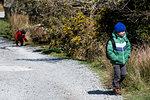 Boys exploring national park, Llanaber, Gwynedd, United Kingdom