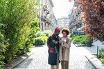 Couple enjoying ice-cream on street, Milan, Italy