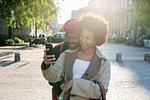 Couple taking selfie in street, Milan, Italy