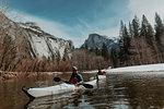 Friends kayaking in lake, Yosemite Village, California, United States