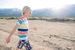 Boy exploring rural landscape, Olancha, California, US