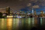 Manhattan skyline and Brooklyn Bridge at dusk