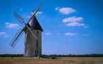 Windmill on field