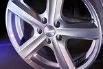 closeup of alloy wheel on dark background