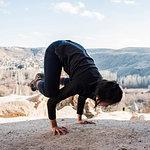 Woman practising yoga in Selime Monastery, Göreme, Cappadocia, Nevsehir, Turkey