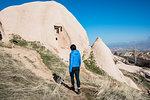 Woman exploring Uchisar Castle, Göreme, Cappadocia, Nevsehir, Turkey