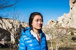 Woman exploring rocky valley, Göreme, Cappadocia, Nevsehir, Turkey