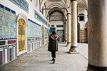Woman exploring Topkapi Palace, Istanbul, Turkey