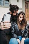 Couple taking selfie on steps