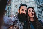 Couple taking selfie in cafe, Santa Maria del Fiore, Firenze, Toscana, Italy