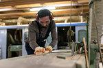 Carpenter working in factory
