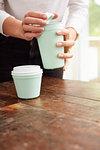 Woman using reusable coffee cup