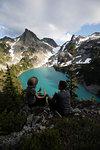 Couple enjoying scenic view, Alpine Blue Lake, Washington, USA