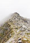 Fog and snow on rocky mountain ranges, Gmund, Tirol, Austria