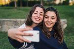Sisters taking selfie in park