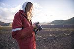 Hiker looking at camera, Landmannalaugar, Highlands, Iceland