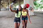 Friends taking selfie in city