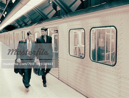 Businessmen in Subway Station