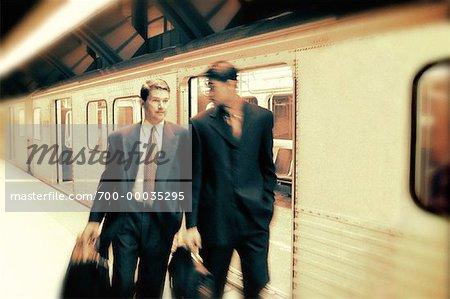Businessmen Leaving Subway Train