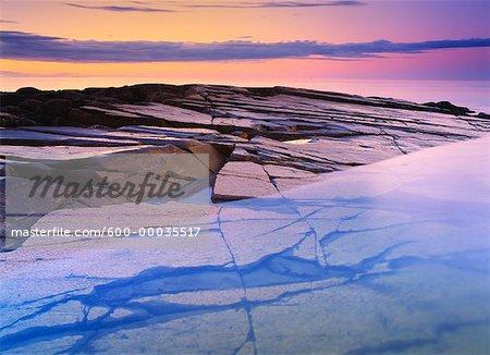 Glacial Polished Canadian Shield Sliding into Hudson Bay Cape Merry, Manitoba, Canada