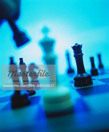 Hand Lifting Chess Piece