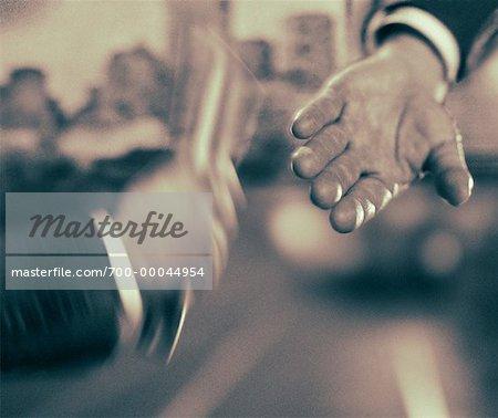 Close-Up of Businessmen's Hands Passing Baton