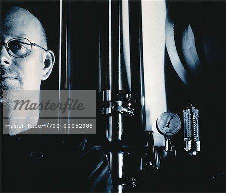 Portrait of Worker Standing near Gauge in Brewery