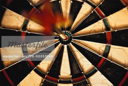 Close-Up of Dart in Bull's Eye on Dartboard