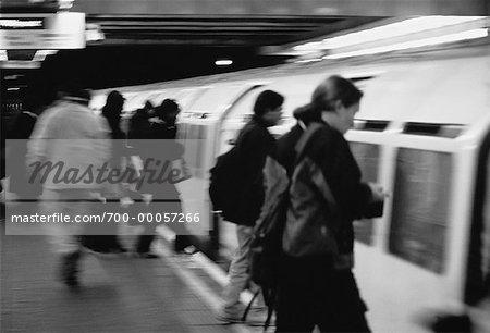 People Entering Train Cars London, England