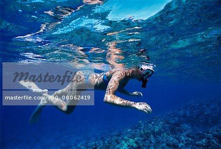 Underwater View of Woman Snorkelling near Molokini Island Maui, Hawaii, USA