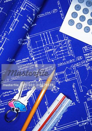 Keys, Pencil, Calculator and Ruler on Blueprints